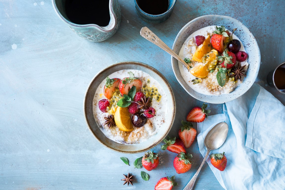 Two bowls of healthy porridge with fruit