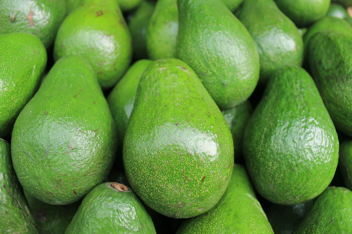 Pile of ripe avocados.