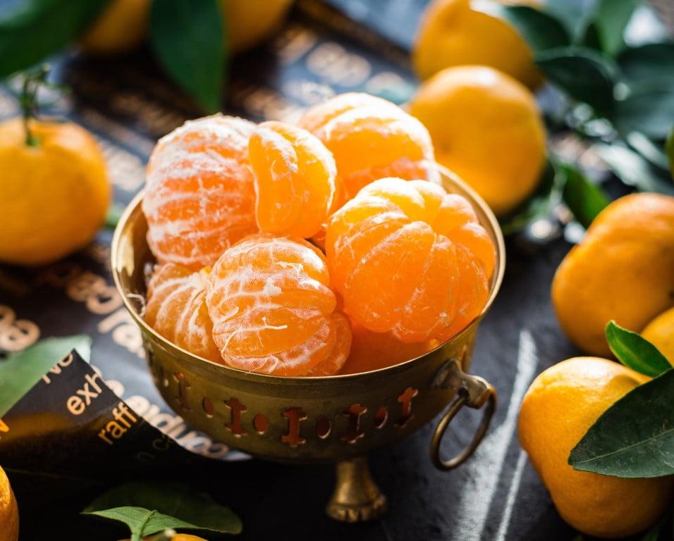 Image of Fresh Juicy Tangerines In a Black Bowl